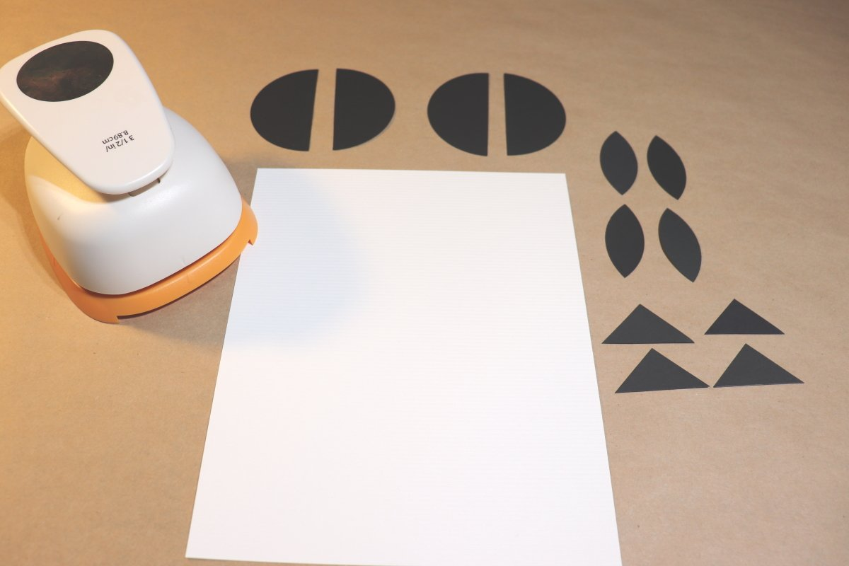 White paper with black circles and circle punch