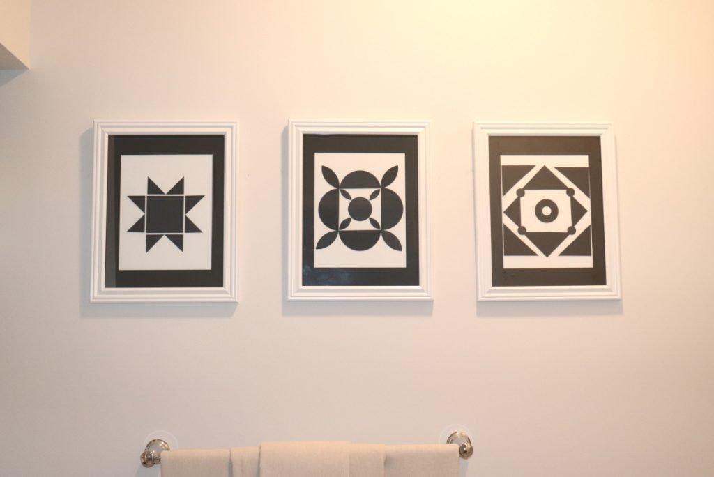 Three black and White photos on walls