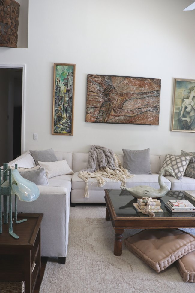 living room with couch and artwork