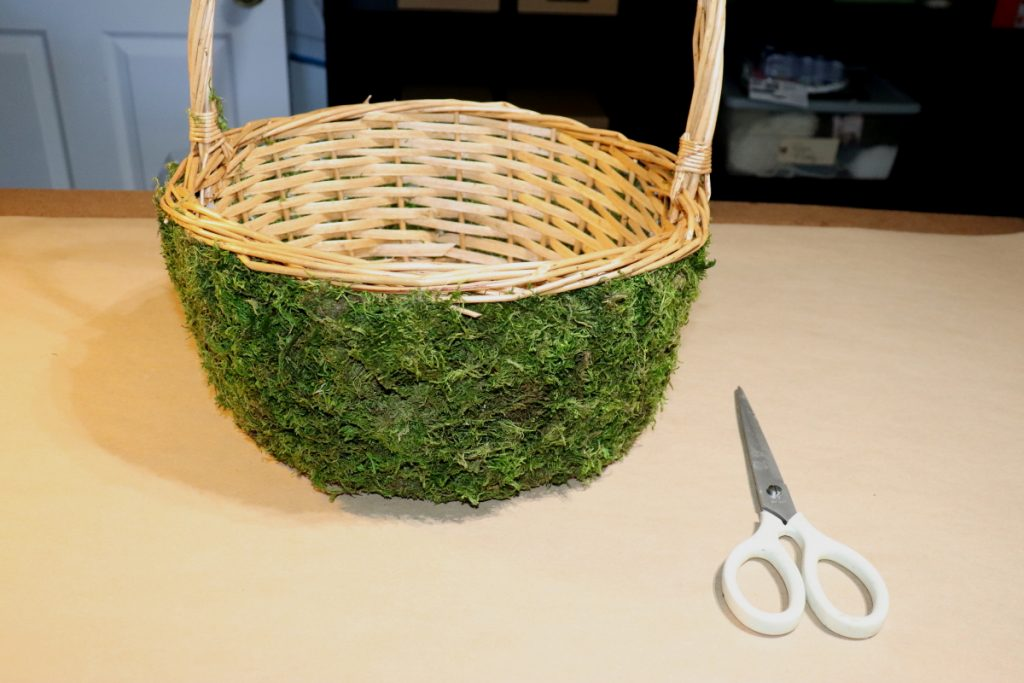 Wicker basket with floral grass on the sides.