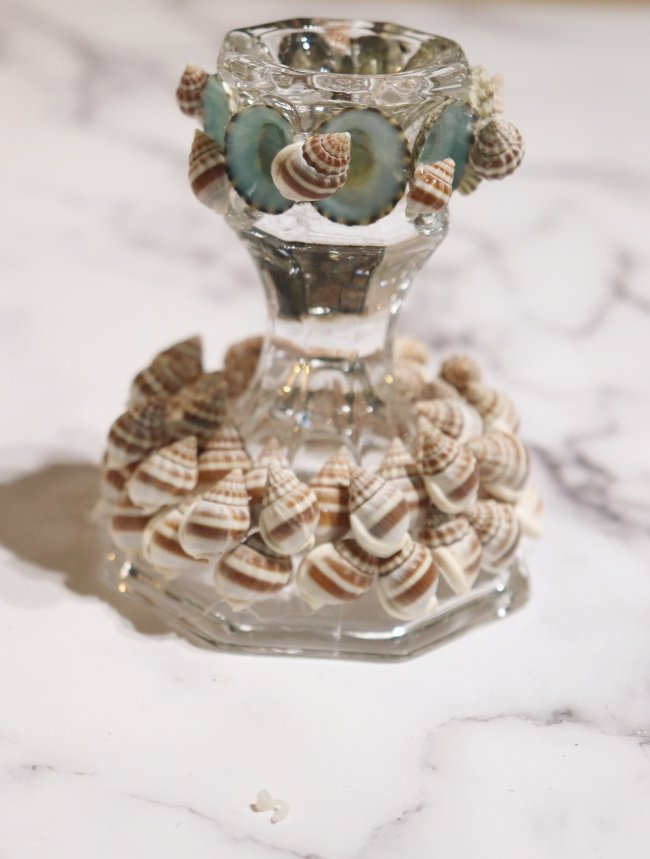 Candle stick decorated with shells