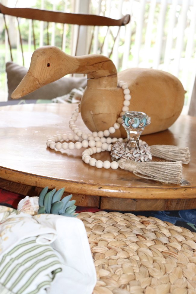 candlestick holder on table with duck