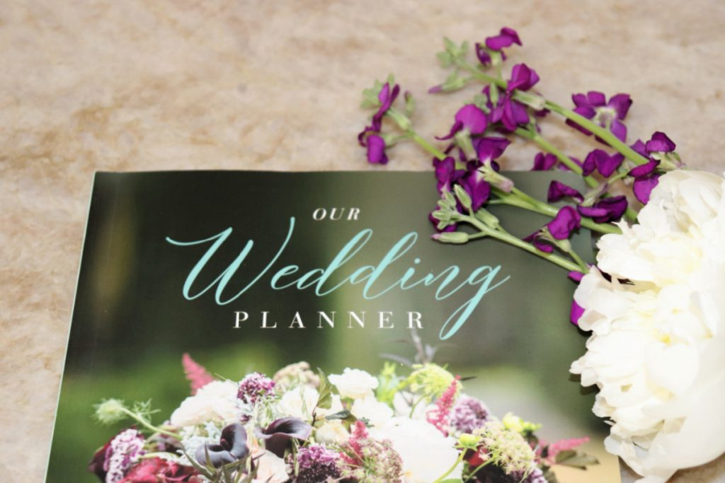 The title of a wedding planner book with flowers
