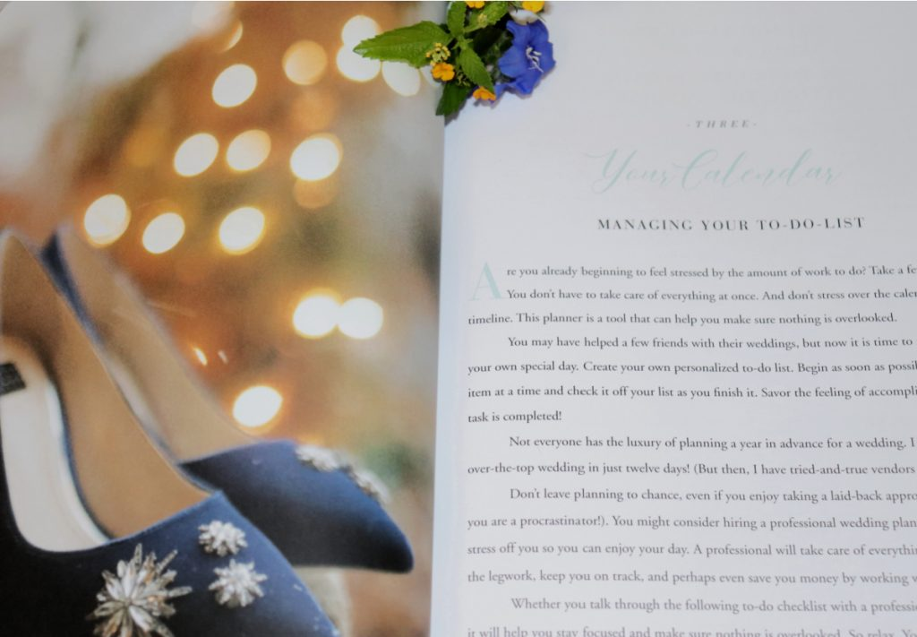 Calender page of a wedding planner book with a picture of blue shoes