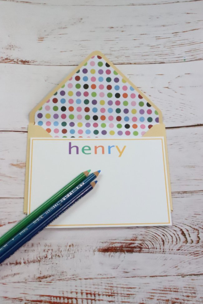 This DIY notecard is yellow with colorful polka dots for the insert. The card is white with a yellow border and the word HENRY in different colored letters